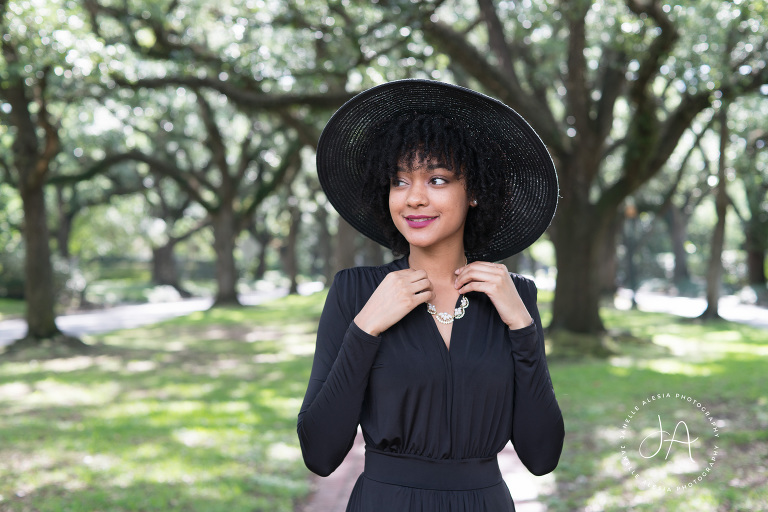 woman in black hat and black outfit outside in nature